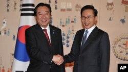 韩国总统李明博(右)10月19日在首尔会晤到访的日本首相野田佳彦