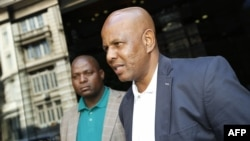 Joseph Mathunjwa (R), President of the Association of Mineworkers and Construction Union (AMCU) arrives at a mediation meeting in Johannesburg, Jan. 24, 2014.