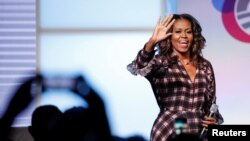 FILE - Former first lady Michelle Obama arrives on stage before speaking during the second day of the first Obama Foundation Summit in Chicago, Nov. 1, 2017.