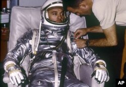 1961: Astronaut Alan B. Shepard, Jr. during suiting for the first manned suborbital flight, MR-3 mission. The Freedom 7 spacecraft, carrying the first American, Astronaut Shepard and boosted by the Mercury-Redstone launch vehicle, lifted off on May 5, 1961.