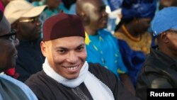 Karim Wade (C), son of Senegal's former president Abdoulaye Wade, attends a rally by his father's political party Parti Democratique Senegalais (PDS) in Dakar, Dec. 6, 2012.