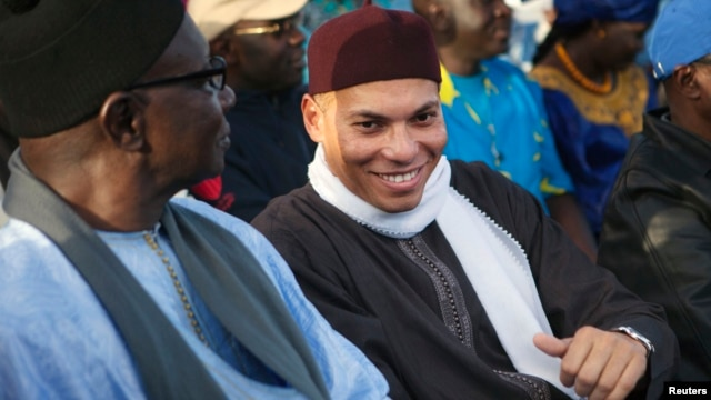 Karim Wade (R), son of Senegal's former president Abdoulaye Wade, attends a rally by his father's political party Parti Democratique Senegalais (PDS) in Dakar, Dec. 6, 2012.