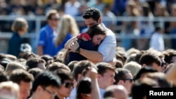 Students console one another at the University of California Santa Barbara during a memorial service in honor of the victims of the shooting there on May 27, 2014.