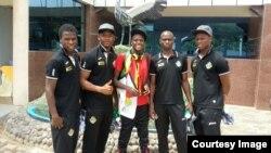 Alvin Zhakata and Zimbabwe soccer players in Rwanda