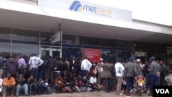 Customers waiting for their turn to withdraw money from the Bulawayo branch of the Metropolitan Bank. (File Photo)