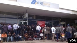 Customers waiting for their turn to withdraw money from the Bulawayo branch of the Metropolitan Bank