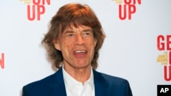 "FILE - Mick Jagger attends the world premiere of ""Get On Up"" at the Ham Yard Hotel in central London, Sept. 14, 2014."
