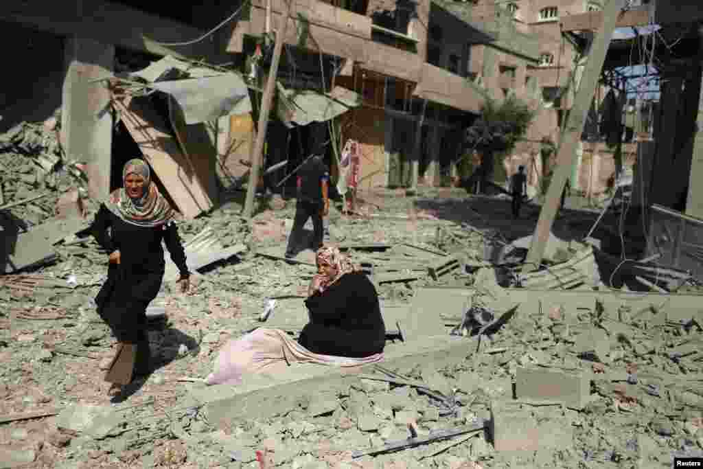 Reconstruction in Gaza, where heavy Israeli bombardment in a war with Islamist militants has caused widespread devastation and displaced half a million people, will cost at least $6 billion, the Palestinian deputy prime minister says. A Palestinian woman