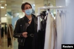 A person shops inside a clothing store amid the coronavirus (COVID-19) pandemic in London on July 6, 2021.