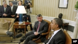 President Barack Obama meets with King Abdullah II of Jordan in the Oval Office of the White House, Jan. 17, 2012.