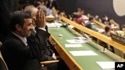 Iranian President Mahmoud Ahmadinejad gestures as he arrives at his seat before addressing the 67th session of the UN General Assembly at UN. headquarters in New York, September 26, 2012.