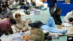 Evacuees gather in a gym in Koriyama, Japan