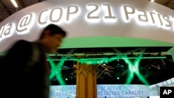 A man walks past the Indian Pavilion at the COP21, the United Nations Climate Change Conference Monday, Dec. 7, 2015 in Le Bourget, north of Paris. (AP Photo/Christophe Ena)