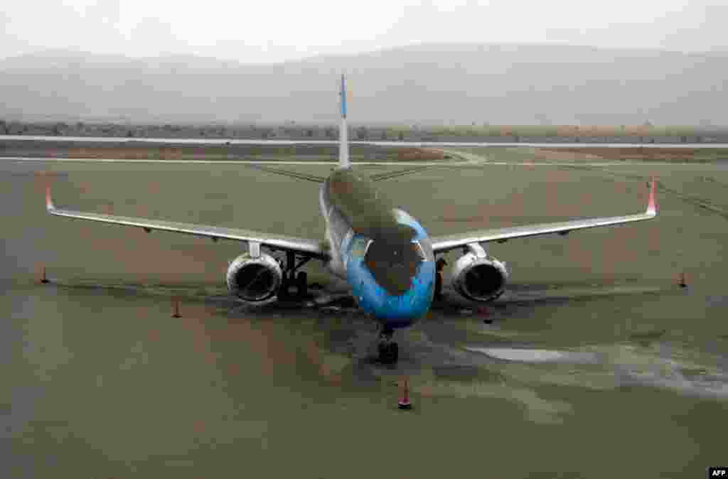 June 7: A plane dusted in volcanic ash sits grounded at the San Carlos de Bariloche airport, Argentina. (AP Photo/Alfredo Leiva)