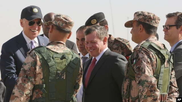 Jordan's King Abdullah II, center, and U.S. Vice President Joe Biden, left, visit a joint Jordanian-American training center at Zarqa, northeast of Amman, Jordan, March 10, 2016.