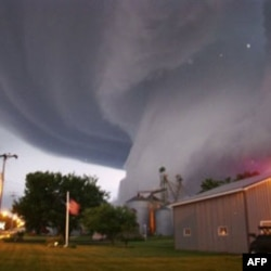 A funnel cloud touches down in Orchard, Iowa, on June 10, 2008