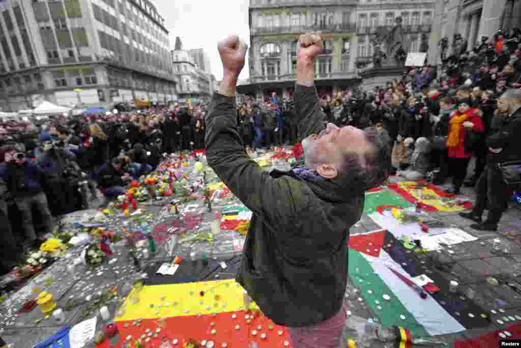 A man reacts at a street memorial following Tuesday's bomb attacks in Brussels, March 23, 2016.
