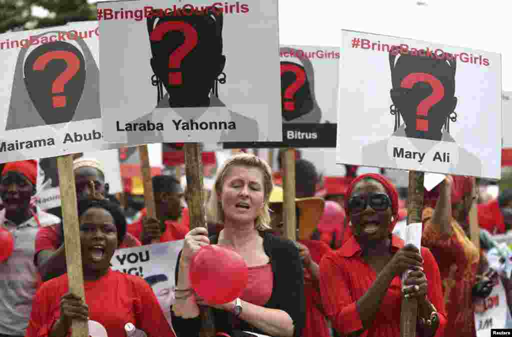 Women carry placards as they attend a protest demanding the release of abducted secondary school girls in the remote village of Chibok, in Lagos, Nigeria.