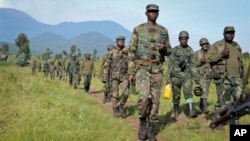 Congolese army soldiers march on a reconnaissance mission near Kibumba Hill, which is occupied by M23 rebels, around 25km from the provincial capital Goma, in eastern Congo Sunday, Oct. 27, 2013. The Congolese army says it has taken two more towns in the