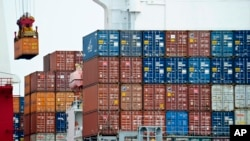 FILE - A container is loaded onto a cargo ship at the Tianjin port in China. The United States has formally told the World Trade Organization (WTO) that it opposes granting China market economy status