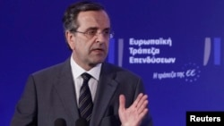 FILE - Greece's Prime Minister Antonis Samaras delivers his speech during an agreement signing with the European Investment Bank (EIB) in Athens, June 12, 2013.