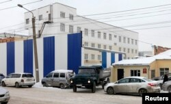 A truck leaves prison hospital number 1 where Nadezhda Tolokonnikova of Pussy Riot group is being held in Krasnoyarsk, Russia, Dec. 19, 2013.