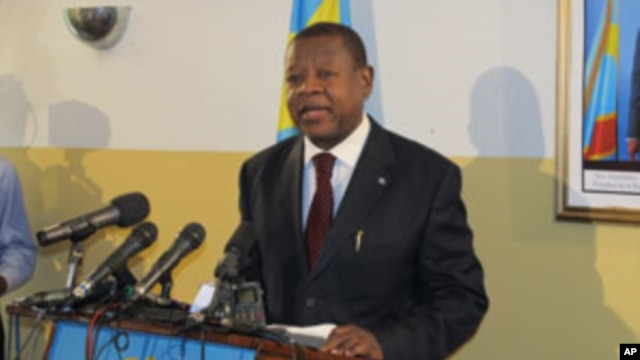 FILE - DRC Communications minister and governement spokesman, Lambert Mende, giving a press conference at his office, in Kinshasa.