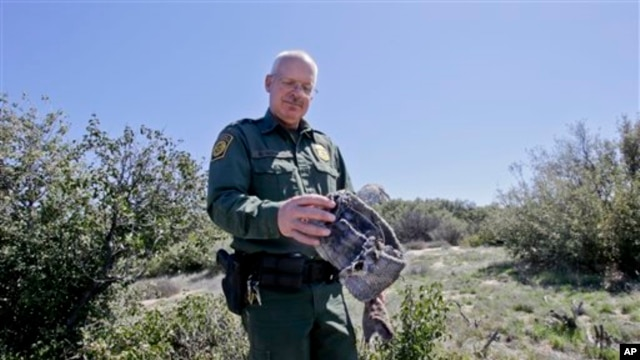 California Border Patrol agent Richard Gordon holds a carpet and wire wrap which illegal immigrants use to disguise their footprints after entering the U.S., March 25, 2013.