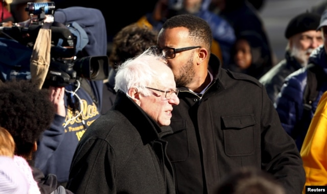 "Democratic U.S. presidential candidate Bernie Sanders arrives after participating in a march before ""King Day at the Dome 2016"" ceremonies in front of the South Carolina State House in Columbia, S.C., Jan. 18, 2016."