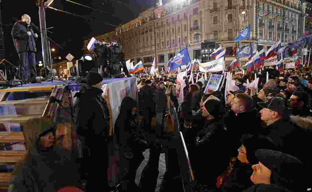 Presidential candidate Vladimir Putin addresses a massive rally of his supporters outside Kremlin, in Moscow, Russia, March 4, 2012. (AP)