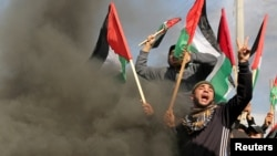 Palestinians take part in a protest