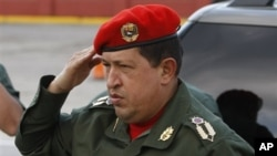 Venezuela's President Hugo Chavez salutes upon his arrival to the Fort Tiuna military base to welcome Ecuador's President Rafael Correa in Caracas, Venezuela, 14 Dec 2010
