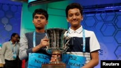 FILE - Co-champions Nihar Janga, left, and Jairam Hathwar hold their trophy upon completion of the final round of Scripps National Spelling Bee at National Harbor, Maryland, May 26, 2016.