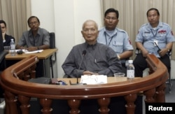 FILE - Nuon Chea, Pol Pot's right hand man of the Khmer Rouge regime, sits in the dock during his first public appearance at the Extraordinary Chambers in the Courts of Cambodia (ECCC) on the outskirts of Phnom Penh February 4, 2008. Noun Chea passed away in 2019. (REUTERS/Chor Sokunthea)