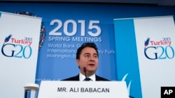FILE - Ali Babacan, deputy prime minister at the time, is seen speaking during a news conference at the International Monetary Fund and World Bank meetings in Washington, April 17, 2015.