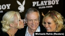 FILE - Playboy magazine founder Hugh Hefner seen here with Kendra Wilkinson (L) and Bridget Marquardt for his 80th birthday party on May 31, 2006. (REUTERS/Michaela Rehle/File Photo)