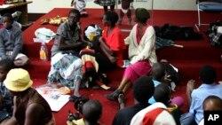 Des réfugiés en provenance de la RDC dans un camp à Harare, Zimbabwe, 4 février 2011.