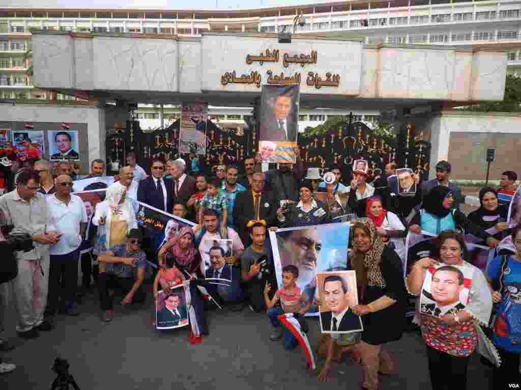 On the anniversary of Egypt's 1973 military victory in the Sinai Peninsula, supporters of then-General Hosni Mubarak celebrate outside the hospital where he is being treated. The ousted president is set to stand trial again next month, Cairo, Oct. 6, 2015.