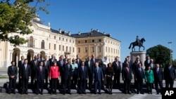 Foto bersama para kepala negara peserta KTTG20 di St.Petersburg (6/9). G20 berkeinginan menaikkan pajak terhadap perusahaan multinasional.