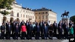 Los líderes del G-20 posan para la foto oficial en San Petersburgo, Rusia.