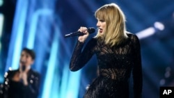 FILE - Taylor Swift performs at DIRECTV NOW Super Saturday Night Concert at Club Nomadic in Houston, Texas.