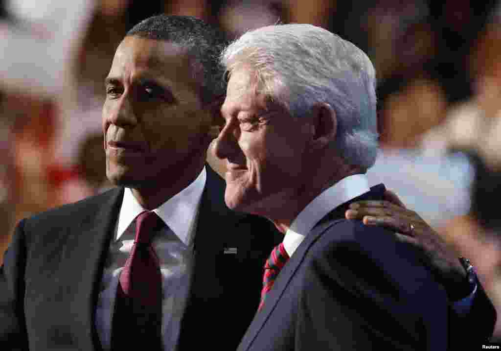 U.S. President Barack Obama (L) embraces former President Bill Clinton onstage after Clinton nominated Obama for re-election during the second session of Democratic National Convention in Charlotte, North Carolina, September 5, 2012