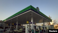 Motorists at petrol station in Islamabad. Pakistan increased petrol prices