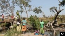 Women stand between the borders of Uganda and South Sudan near Bibi Bidi, Uganda. Thousands of refugees have fled South Sudan into Uganda, creating huge refugee settlements.