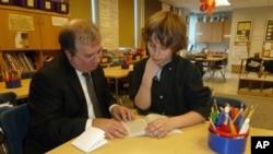 Mentor Tony Boccia and mentee Baily Raffensperger go over a reading assignment.
