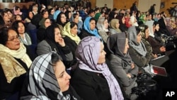 Afghan women listen to Afghan President Hamid Karzai, during a speech about women's rights, in Kabul.