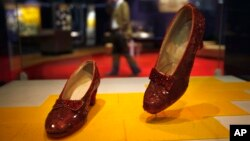 "FILE - Dorothy's ruby slippers from ""The Wizard of Oz"" movie are seen on display at the Smithsonian National Museum of American History in Washington, April 11, 2012."