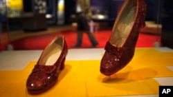 """FILE - Dorothy's ruby slippers from""""The Wizard of Oz"""" are seen on display at the Smithsonian National Museum of American History in Washington, D.C., April 11, 2012."""