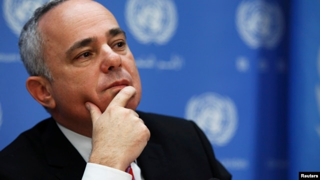 FILE - Minister of Strategic and Intelligence Affairs for International Relations of Israel Yuval Steinitz listens during a news conference.