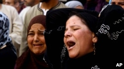 Egyptian women weep after a judge sentenced to death more than 680 alleged supporters of the country's ousted president over acts of violence and the murder of a policeman in the latest mass trial in the southern city of Minya, Egypt, April 28, 2014.